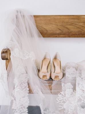 BHLDN peep toe scallop wedding heel on wood bench with peter langner veil guatemala wedding