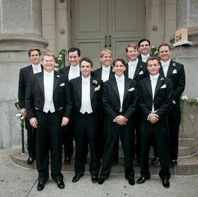 Men outside in long tail tuxdos