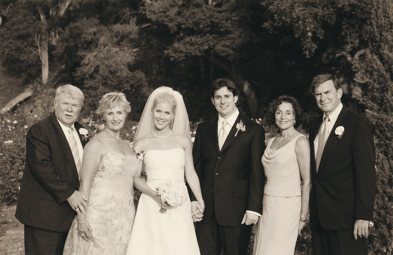 Black and white photo of newlyweds with their mothers and fathers