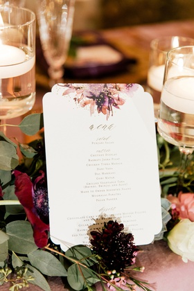wedding menu with die cut border purple amber gold flower print motif on table gold lettering