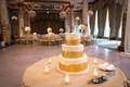 three-tier white wedding cake with gold sequin details