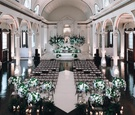 vibiana indoor wedding ceremony, indoor wedding with white and green floral arrangements