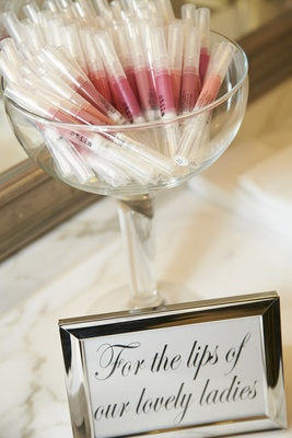 Sign in silver frame with bowl of Stila lipstick