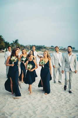 bridesmaids blue dresses groomsmen gray suits beach punta mita mexico destination wedding beach sand