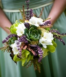 Bridesmaid's bouquet of green and white flowers with lavender and succulents