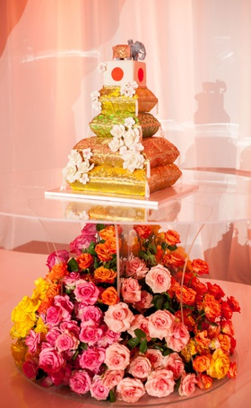 wedding cake with cushions japanese flag cube elephant on top roses on lucite stand