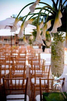 Wedding ceremony aisle flower arrangement calla lily flowers