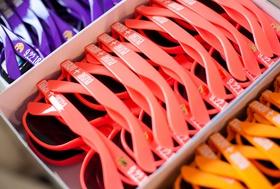 wedding ceremony favors sunglasses in purple pink red orange shades