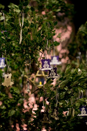 Greenery tree with escort cards hanging from it old world fantasy theme Hunter Pence and Alexis