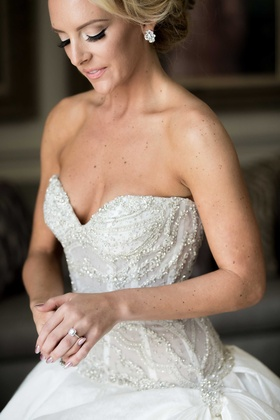Bride in strapless beaded Ines Di Santo wedding dress with beautiful square diamond engagement ring