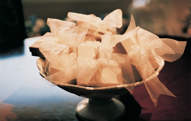 Bowl of favors tied with ribbon