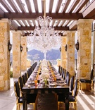 malibu rocky oaks reception, long black table with black and gold chairs, crystal chandelier