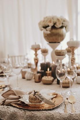 fall wedding ideas pumpkin with place card ribbon gold charger flatware pumpkin centerpiece candles