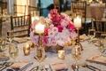 Low flower centerpiece at ballroom wedding reception