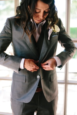 same-sex wedding, bride buttons jacket of art lewin bespoke suit