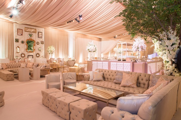 Wedding lounge area tufted sofa ottoman trees mirrors Texas wedding decor