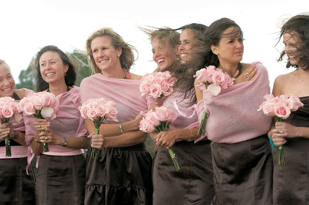 Bridesmaids on windy day with brown dresses and pink sweaters