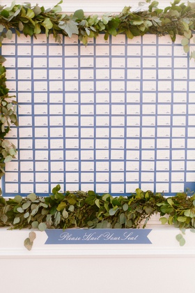 wedding reception wall display of escort cards on blue background taxi car service theme please hail