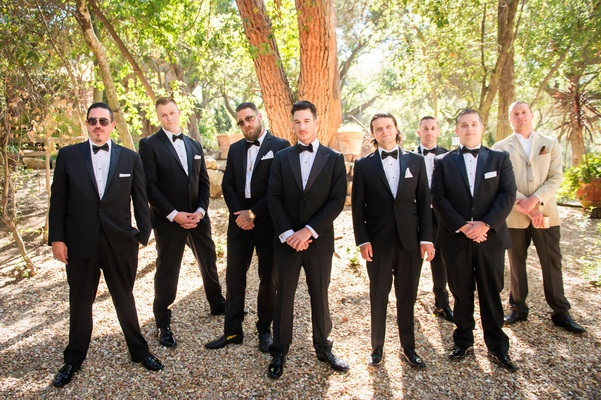 groom in armani collezioni, groomsmen pose in the woods