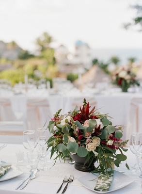 Wedding rehearsal dinner welcome party centerpiece Mexico destination wedding eucalyptus red flowers
