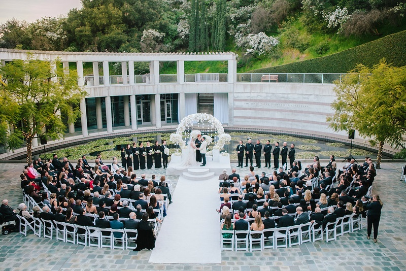 wedding at skirball cultural center, guests in semi-circle watch