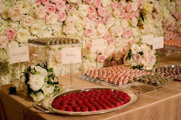 wedding reception dessert table flower wall pink white rose painted truffle candies peanut brittle