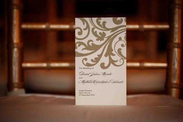 Wedding program with gold scrolls