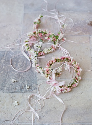 Flower crowns with white and light pink flowers tied with pink satin ribbon