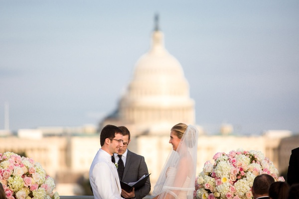 Bride and groom rooftop wedding ceremony altar officiant exchange vows united states capitol