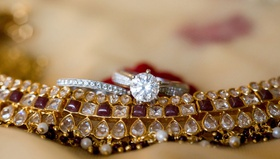 indian wedding jewelry with solitaire engagement ring and pave diamond band on top
