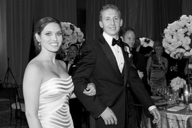 Black and white photo of bride in a strapless Vera Wang gown with groom in a tuxedo and bow tie