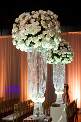 White rose and white hydrangea flower arrangement on top of Swarovski crystal risers