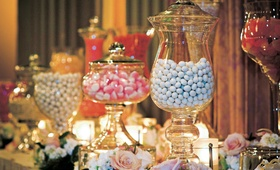 Wedding candy station with beautiful glass containers