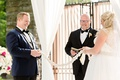 bride and groom holding strong cord unity braid uncle performing ceremony officiant custom tradition