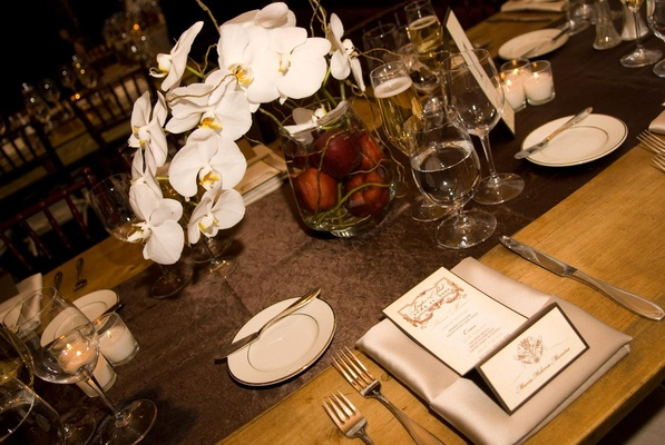 Black tie wedding reception table in rustic setting