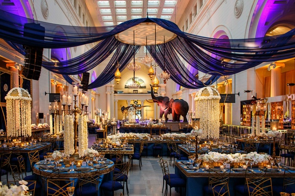 Wedding celebration featuring bright colors opulent reception space concept in blue gold and purple in chicago museum