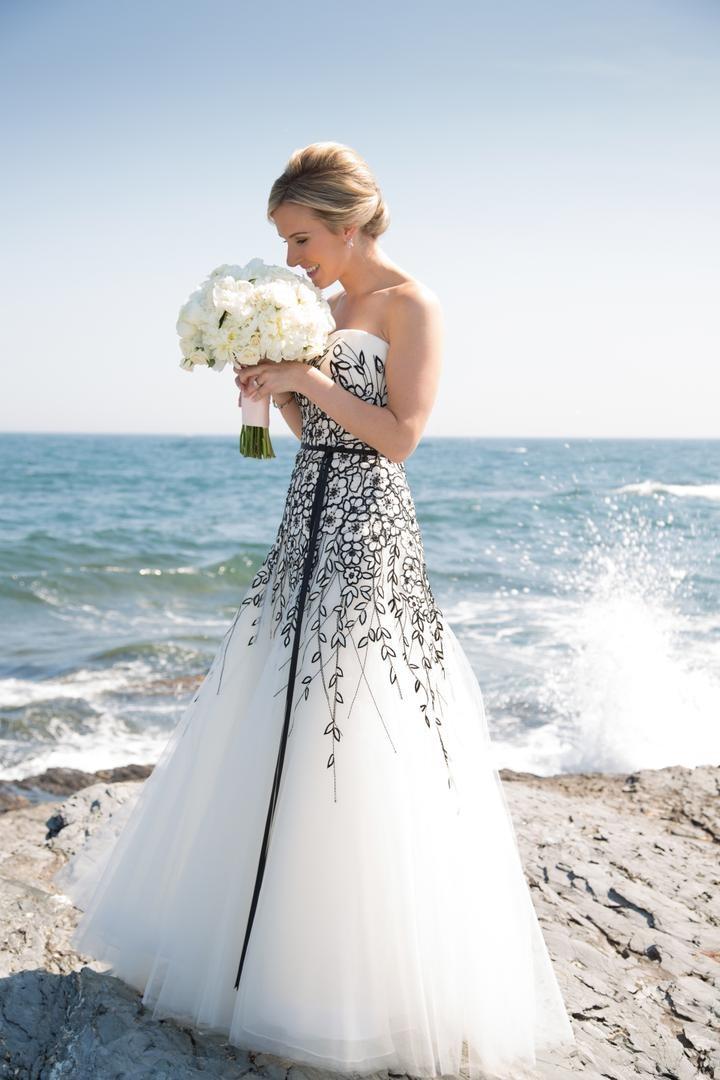 Bride on coast in Carolina Herrera wedding dress