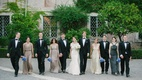 groomsmen and brides in mismatched dresses carrying blue bouquets