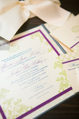 Rhinestone-studded invite with monogram and motif