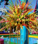 a vibrant floral arrangement of long stems and white orange and pink flowers