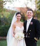 Bride in spaghetti strap Amsale wedding dress v neck veil updo with groom in white bow tie navy