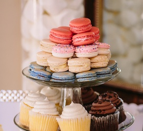 macarons, cupcakes, sprinkle-covered pretzels, cookies on tiered stand for wedding sweets table