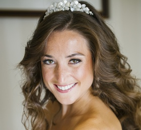 Bride with hair in curls and pink lipstick