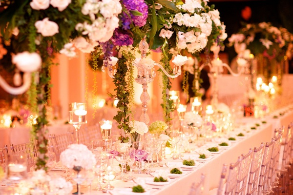 tall white and purple floral centerpieces candles white tablescape