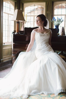 bride reclining bateau neck wedding gown dayton ohio ines di santo classic stylish
