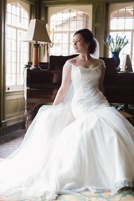 Bride Reclining Bateau Neck Wedding Gown Dayton Ohio Ines Di Santo Classic Stylish