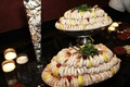 Tiered stand filled with shrimp at wedding reception