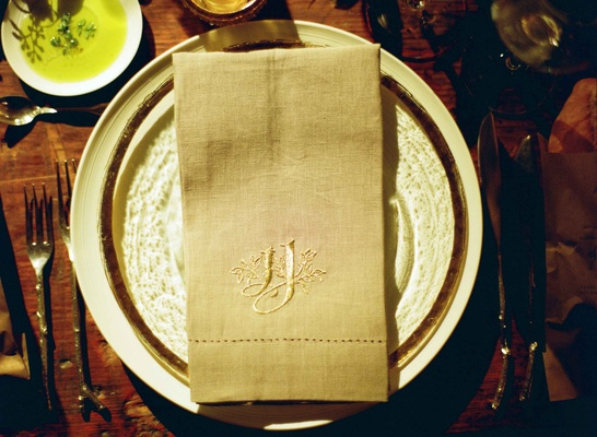 Custom grey hemstitch napkins at wedding reception place setting custom monogram embroidered