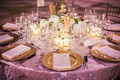Glam wedding reception with gold charger plates
