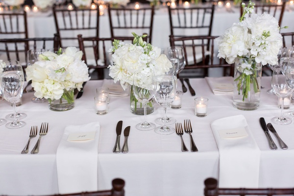 wedding reception classic decor white linen white flower centerpiece silver flatware